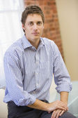 Businessman sitting in office — Stock Photo