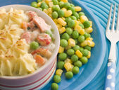 Individual Fish Pie with Peas and Sweetcorn — Stock Photo