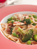 Pasta Bows with Tomato Sauce Broccoli and Peas — Stock Photo