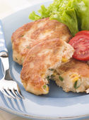 Cod and Salmon Fish Cakes with Corn and Salad — Stock Photo