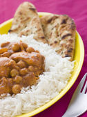 Chicken and Chickpea Curry with Rice and Naan Bread — Stock Photo
