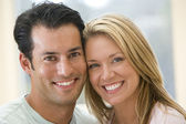 Couple indoors smiling — Stock Photo