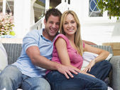 Couple sittng outside — Stock Photo