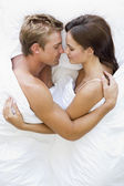 Couple lying in bed sleeping — Foto de Stock