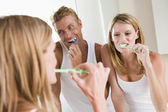Couple in bathroom brushing teeth — Foto de Stock