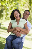 Couple being playful outdoors smiling — Stock Photo