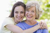 Two women outdoors smiling — Stock Photo
