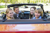 Family in convertible car smiling — Photo