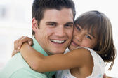 Man and young girl hugging and smiling — Stock Photo