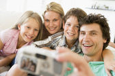 Family taking self portrait with digital camera — Stock Photo