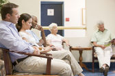 Five waiting in waiting room — Stockfoto