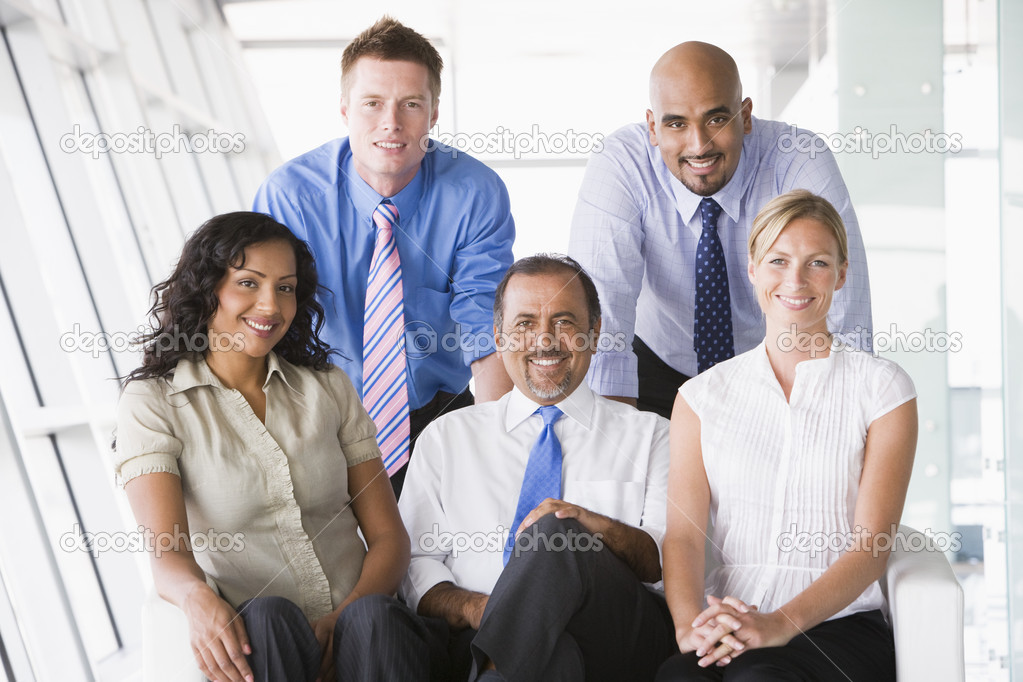 Group of businesspeople in office lobby — Stock Photo #4760051