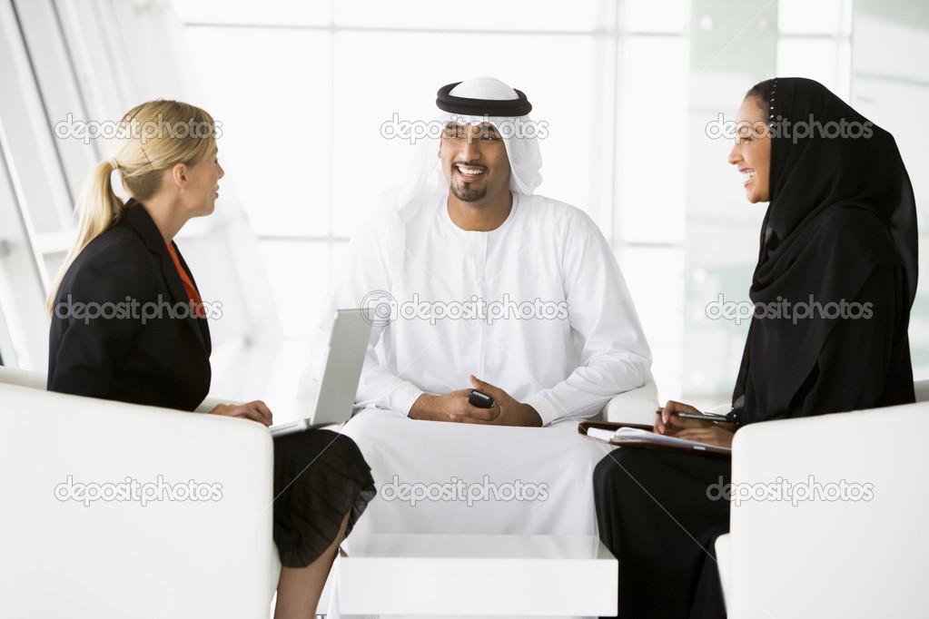 A Middle Eastern man and woman and a caucasian woman talking at — Stock Photo #4760231