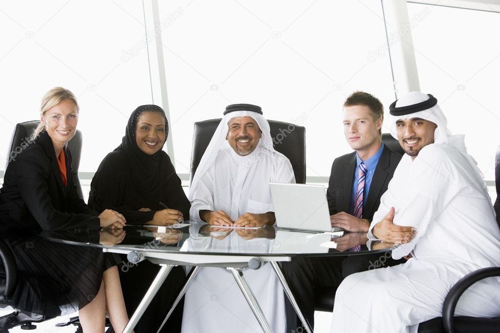 A  business meeting with Middle Eastern and caucasian men and wo — Stock Photo #4760276