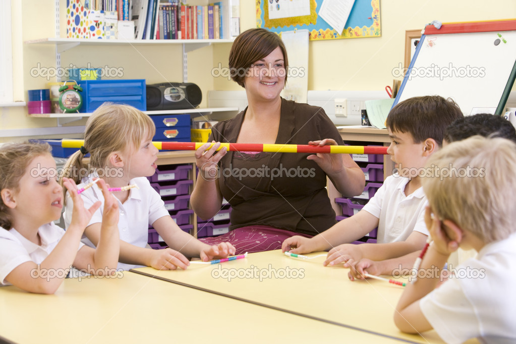 Schoolchildren and their teacher in a primary class — Stock Photo #4761131