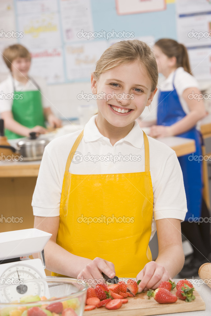 Schoolgirl at school in a cooking class — Stock Photo #4761365