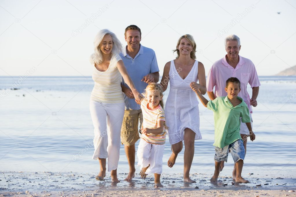 Extended family walking on beach — Stock Photo #4763562