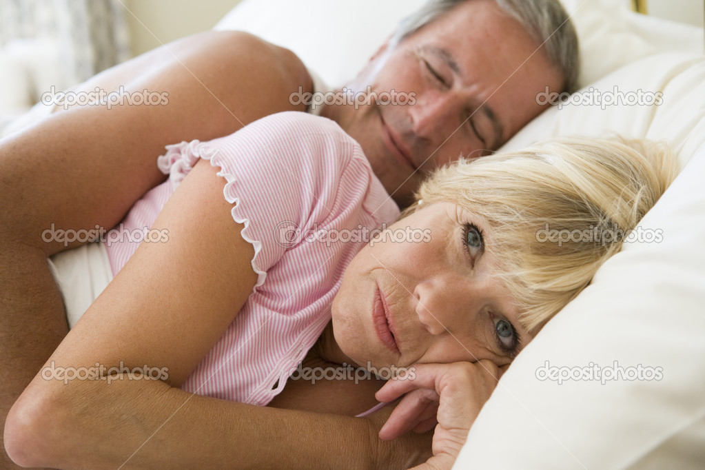Couple lying in bed together stock photo for Sexy bed photos
