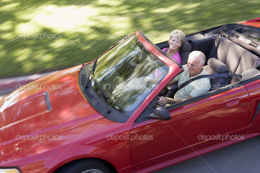 Couple in convertible car smiling  Stock Photo #4765088