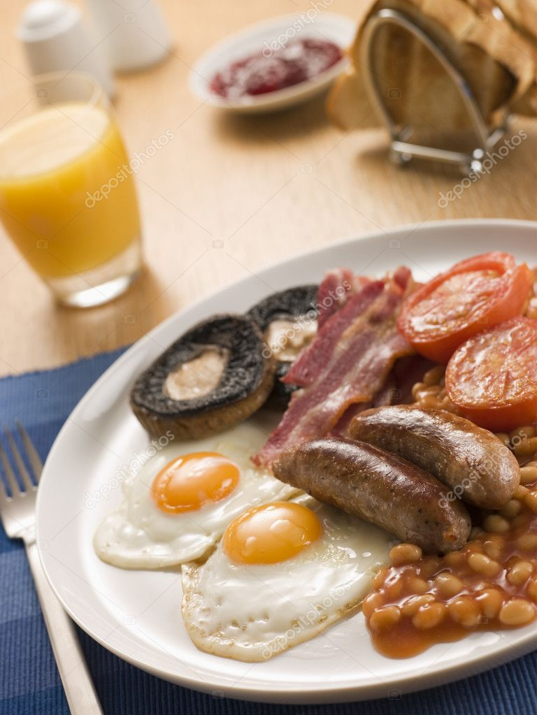 Full English Breakfast with Orange Juice Toast and Jam — Stock Photo #4766208