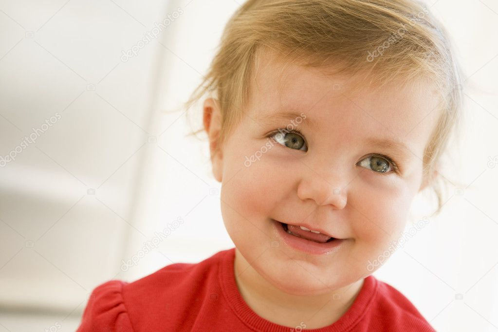 Baby indoors smiling  Stock Photo #4766451