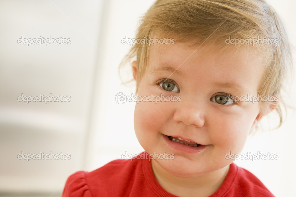 Baby indoors smiling  Stock Photo #4766454