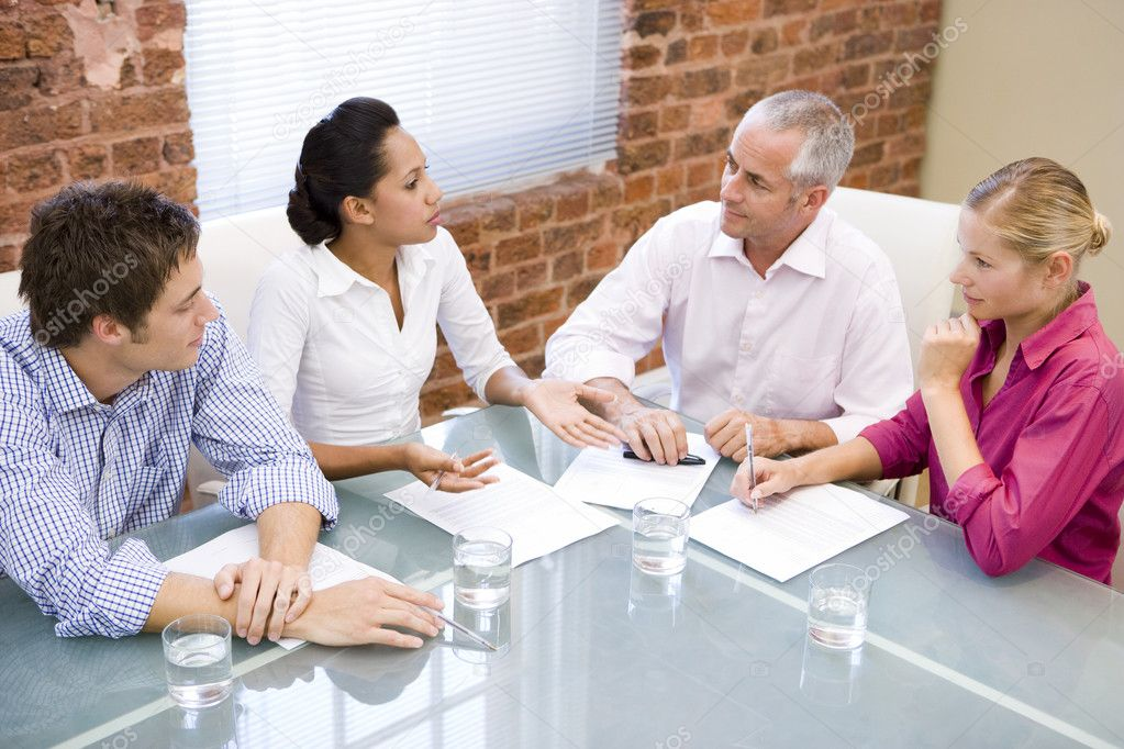 Four businesspeople in boardroom meeting — Stock Photo #4767337