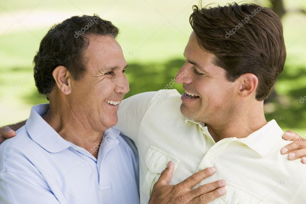 Two men standing outdoors bonding and smiling — Stock Photo #4768057