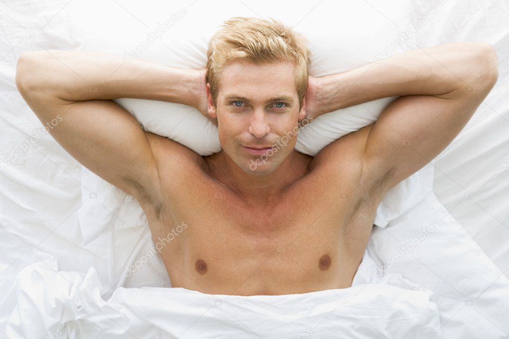 Man lying in bed relaxing — Stock Photo #4768939