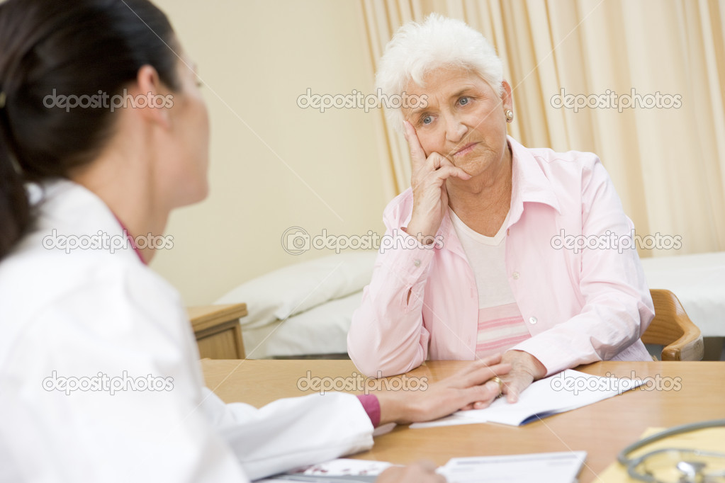 Woman in doctor's office frowning — Stock Photo #4769192