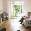 Woman in living room watching television — Stock Photo #4770103
