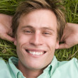 Man lying on grass smiling — Stock Photo #4770169