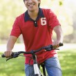 Man outdoors on bike smiling — Stock Photo #4770223