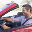 Mdriving convertible car smiling — Stock Photo #4770277