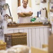 Man in birdhouse store smiling - Foto de Stock