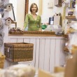 Woman in birdhouse store smiling - Foto de Stock