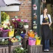 Woman working at flower shop smiling — Stockfoto #4770325