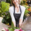 Royalty-Free Stock Photo: Woman working at flower shop smiling