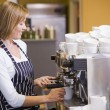 Stock Photo: Woman making coffee in restaurant smiling