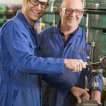 Two machinists working on machine — Stock Photo