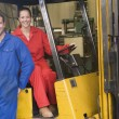 Two warehouse workers with forklift — Stock Photo