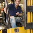 Warehouse worker in forklift — Stock Photo #4770449