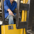 Warehouse worker in forklift — Lizenzfreies Foto