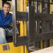 Warehouse worker in forklift — Foto Stock