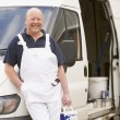 Royalty-Free Stock Photo: Painter standing with van smiling