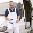 Painter standing with van smiling — Stock Photo #4770488