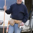 Plumber standing with van smiling — Stock Photo