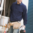 Plumber standing with van smiling — Stock Photo #4770493