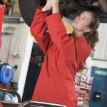 Mechanic working under car — Stock Photo