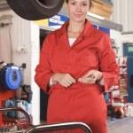 Mechanic working under car smiling — Stock Photo